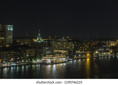 Night time view of Savannah at river street taken as an aerial view across the Savannah River