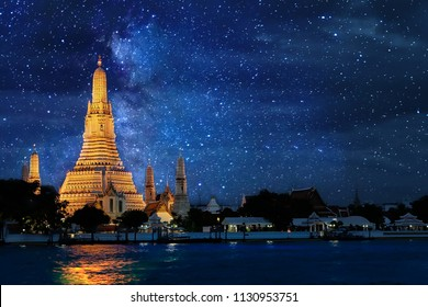 Night time view of Wat Arun Temple in bangkok Thailand  and Milky way galaxy stars and space dust in the universe background.
