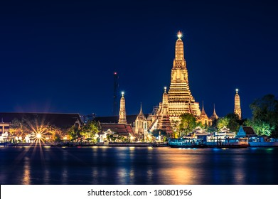 Night time view of Wat Arun (Temple)  across Chao Phraya River in Bangkok, Thailand.