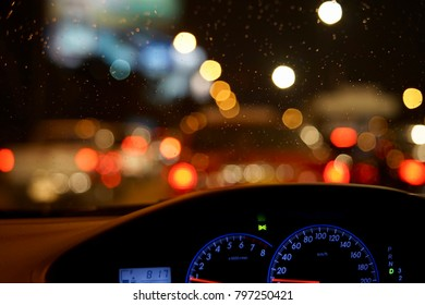 Night traffic bokeh on rainy day