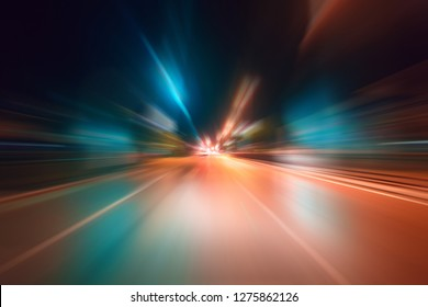 Night traffic with futuristic motion blur & zoom effects. On the road or streets, shoot from inside a moving car.