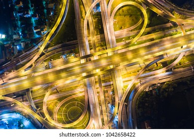 Night traffic intersection city road with vehicle movement aerial view from drone