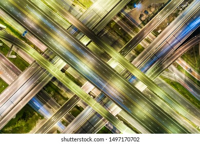 Night traffic junction road with light of vehicle movement aerial view from drone