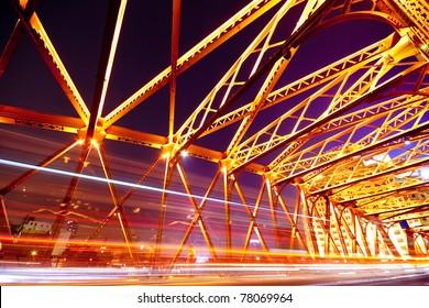 night traffic lights inside of steel bridge