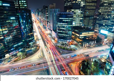 Night traffic speeds through an intersection in the Gangnam district of Seoul.