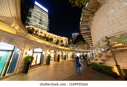 Night view of 1881 Heritage (Former Marine Police Headquarters), a redeveloped hotel & commercial architecture in Tsim Sha Tsui, Kowloon, Hong Kong, with the One Peking office tower standing behind