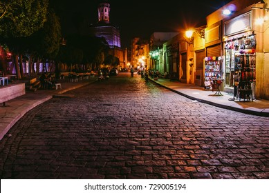 A night view for al Muizz Street considered oldest street of the medieval islamic era in Cairo, in the background is the famous Minaret of Al Hakim Mosque or as nicknamed Al Anwar Mosque