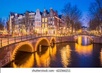 Night view of Amsterdam city skyline at night in Netherlands.