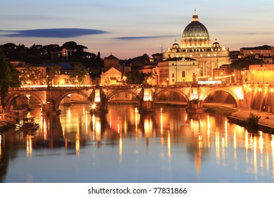Night view at the Angelo Bridge and St. Peter's Basilica in Rome, Italy