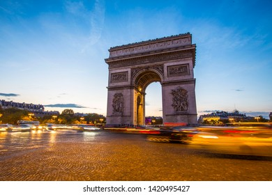 The night view of Arc de Triomphe in Paris, France.