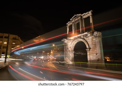 Night view Arch of Hadrian that leads to the pillars of Zeus's archaeological site.