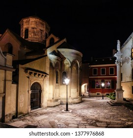 Night view to the Armenian Cathedral of the Assumption of Mary in Lviv, Ukraine. Night street of the European medieval city. Concept  - travel, landmarks, monument of architecture, world heritage