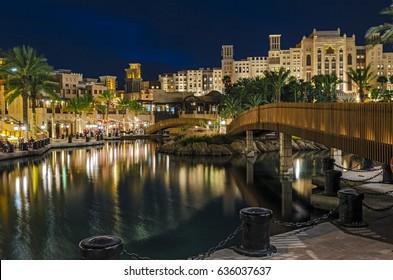 Night view of the artificial canal, Souk Madinat Jumeirah on the Arabian Gulf. Dubai, United Arab Emirates.
