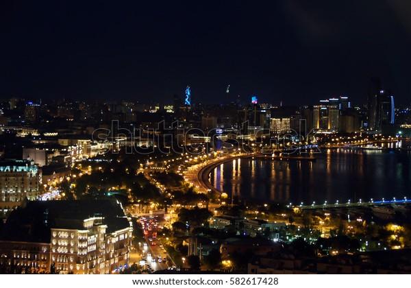 Night View of the Baku. Building Night view of Baku city panoramic.Baku city  design bird view Night Bright lights. Night street city lights bird view. beautiful city Baku lights.