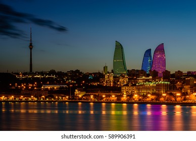 Night view of Baku with the Flame Towers skyscrapers, television tower and the seaside of the Caspian sea, Baku, Azerbaijan.