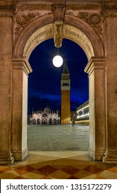 Night view of Basilica di San Marco and Campanile through the street arch on San Marco in Venice, Italy. Architecture and landmark of Venice. Night cityscape of Venice.