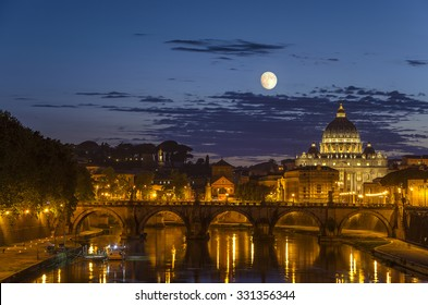 Night view of the Basilica St Peter in Rome under the full moon in Rome - Italy