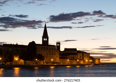 Night view of the bay of Porec in Istria, Croatia in Europe: Euphrasian Basilica on the background