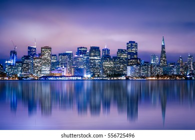 Night view of beautiful San Francisco California city skyline with lit buildings and bay