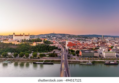 Night view of Bratislava city center with Cathedral, historical buildings, and traffic. Beautiful travel picture of Slovakia.