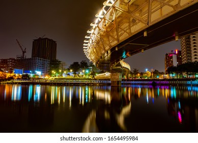 Night view of the bridge at Heart of Love River and building background, Kaohsiung, Taiwan.