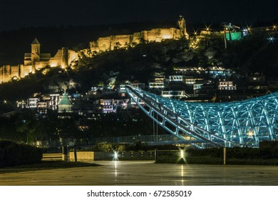 """Night view of the """"Bridge of Peace"""" in Tbilisi. Georgia Country"""