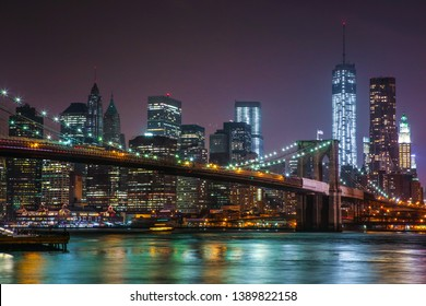 Night view of Brooklyn bridge and Manhattan downtown.