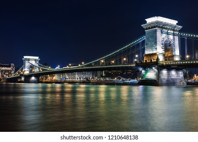 Night view of Budapest. Panorama cityscape of famous tourist destination with Danube and bridges. Travel illuminated landscape in Hungary, Europe.