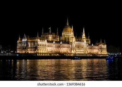 Night view of the Budapest Parliament from the Danube river  in Budapest, Hungary, Europe