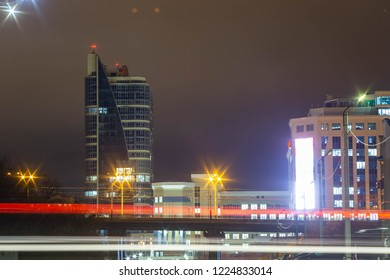 night view of the business center of the Republic in Cheboksary in Russia with a bridge in front of him and the light of passing cars