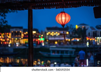 Night view of busy street in Hoi An, Vietnam. Hoi An is the World's Cultural heritage site, famous for mixed cultures and architecture. Focus on paper lantern.
