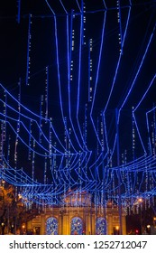 Night view of the Calle de Alcala in Madrid, decorated for Christmas.