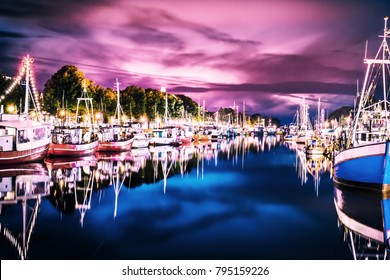 night view of canal with ships and Baltic Sea in Warnemunde, Rostock Germany