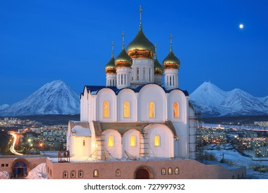 night view with of the cathedral in the city of Petropavlovsk-Kamchatskiy under the moonlight against the volcanos