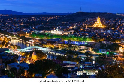 Night view of center Tbilisi city. Cityscape with evening illumination and famous landmarks from Sololaki hill. Georgia