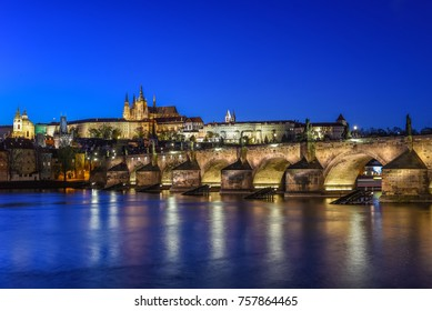 Night view of the Charles Bridge and its reflection in the Vltava River. Prague, Czech Republic