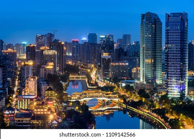 The night view of Chengdu Jiuyanqiao CBD with the traditional Anshun bridge and the modern skyscrapers.
