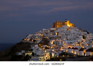 Night view of Chora with the historic Querini Castle at the top - Astypalea Island, Greece