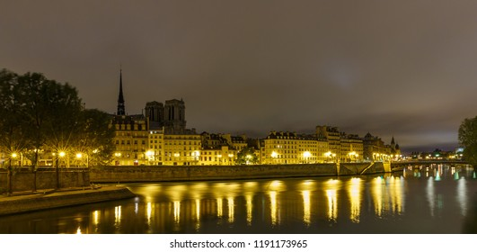 Night view of the Cite island in Paris, France