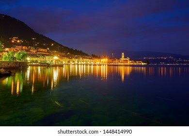 Night view of the city center of Salo on the shores of Lake Garda Italy. Photo taken at long exposure.