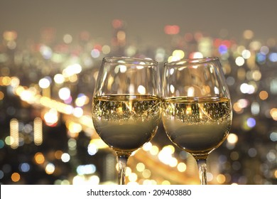 The Night View Of The City Reflected In The Glass Of Wine