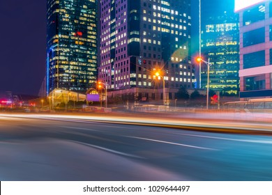 The night view of the city road and the fuzzy car lights in Luji