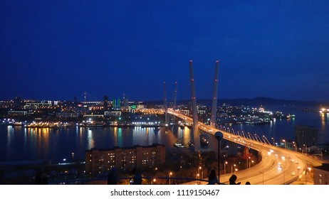 night view of the city of Vladivostok. Russky Bridge, Vladivostok, Russia
