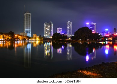 Night View Of Colombo Beira Lake, Skyline And Modern Skyscrapers.  Beira Lake Is A Large Lake In The Heart Of The City Of Colombo That Surrounded By Many Large Businesses In The City