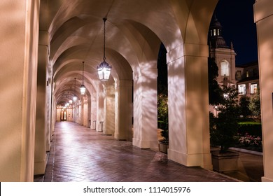 Night view of the colonnade surrounding the historical City Hall building of Pasadena, Los Angeles county, California; the building was completed in 1927;