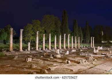 Night view of the columns of the ancient Roman Forum Ruins in Aquileia, Friuli, Italy