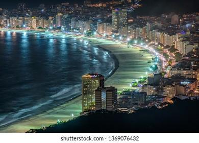 Night view of Copacabana beach and Avenida Atlantica in Rio de Janeiro, Brazil. Copacabana beach is the most famous beach of Rio de Janeiro, Brazil. Skyline of Rio de Janeiro.