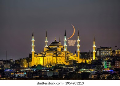 """Night view with crescent moon of the Mosque of Sultan Ahmet, the Blue Mosque ramadan month mosque on the mahya, Istanbul, Turkey. The minaret in turkish """"welcome the eleven months sultana"""" writes."""