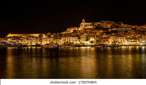 Night view of Dalt Vila, Ibiza old town. Night reflections on the sea.