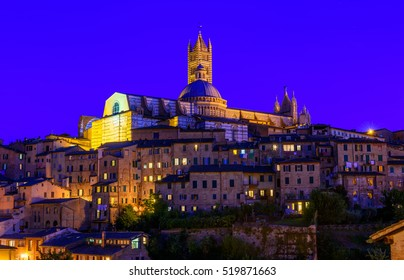 Night view of Dome and campanile of Siena Cathedral (Duomo di Siena) in Siena, Italy. Siena is capital of province of Siena. Historic centre of Siena has been declared by UNESCO a World Heritage Site